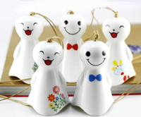 Wholesale Various Smile Doll Designs White Ceramics Wind Charime Car Decoration Home Decoration Ceramics Crafts TC0301