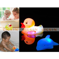 Wholesale Baby Bath Fun LED Flashing Duck Dolphin Toy Rubber Light It Up Touch Base