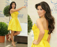 Reference Images Monte Carlo TV Festival  Strapless Kim Kardashian Yellow Mini Celebrity Dresses Floral Strapless Taffeta A-Line Hidden Pockets Knee-Length Monte Carlo TV Festival 2009