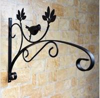 Wholesale Wrought iron wall hanging shelf outdoor balcony flowerpot flower basket frame hanger pot hook hanging shelf support bracket