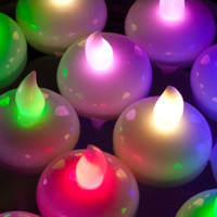 Wholesale 24pcs waterproof flameless colour changing LED floating candle tea light wedding party