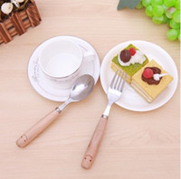 Wholesale Smiling face the wooden handle of stainless steel tableware two piece fork spoon set environmental protection idea