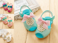Wholesale 2014 ribbon bow baby shoes Cheap pearls Velcro beach sandals PU soft bottom toddler shoes Children s shoes baby wear pair LY