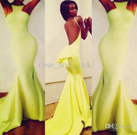 Wholesale Nicole dramatic train cute peplum at the low back daring cutaway halterneck backless yellow Michael Costello Prom Evening Celebrity Dresses