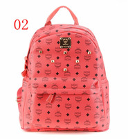 Wholesale 2014pu backpack MCM handbags red color bag backpack computer bag lovers school bag fashion ladies Liu nail Rivet Korea double mc purse back