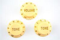 El sistema de crema de 1 tono del volumen 2 pega las perillas de control de la guitarra eléctrica para la venta al por mayor libre del envío de la guitarra del estilo de la defensa