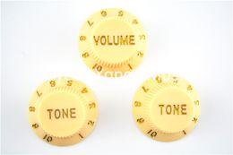 El sistema de crema de 1 tono del volumen 2 pega las perillas de control de la guitarra eléctrica para la venta al por mayor libre del envío de la guitarra del estilo de la defensa desde perillas guitarra fender proveedores