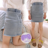 Wholesale 2014 spring girls high sand colored jeans hip pockets slit skirts short skirt
