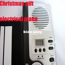 2017 enrollar 61 teclas 61-Key 61 teclas digitales Roll-up suave teclado de piano con MIDI órgano electrónico Para freeshipping Regalo de Navidad de los niños del cabrito descuento enrollar 61 teclas