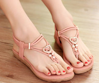 Wholesale Bohemia flat Roman women s shoes pinch Korean style beaded beach new low heel sandals popular sale cheap price