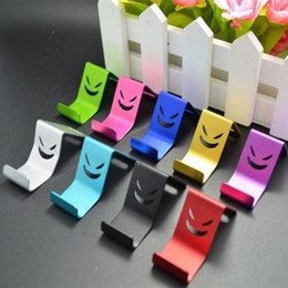 Wholesale Mini Metal Smile Devil Phone Stand Holder for Samsung Galaxy S5 For iphone c s s For ipod itouch Cell Phone