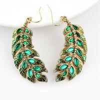 Wholesale Latest style hot sale elegant shiny green leaf rhinestone design gold color alloy long drop earrings for women