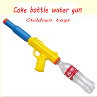 Wholesale Children toys water gun Coke bottle water gun air pressure water gun cap pistol cap gun