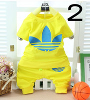 Wholesale Preschool children s clothing baby clothes men and women suits clover short sleeved summer two piece of minutes of pants a years old