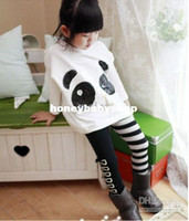 Wholesale girl s spring and autumn leisure suit two piece loose panda logo T shirt black and white striped bow girls leggings AB han