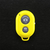 Wholesale 50pcs New arrival Bluetooth Shutter Remote Control Camera for iPhone Samsung HTC Sony Moto iOS Andriod