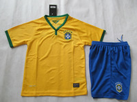 Wholesale 2014 Brazil World Cup Home Kids Kit Yellow Best Quality New Soccer Jerseys Children s Football Shirts Customized Youth Soccer Uniforms