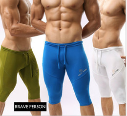 Wholesale mens sports swimming trunks running jogging breeches gym cycling satin cool panties Board shorts mma underwear fitness pants Cropped Trouser