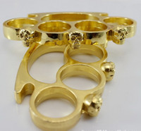 Wholesale New GOld Skull white version handcuffs iron fist four finger PUNCH Martial Arts Products Drop shipping
