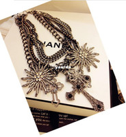 Suspenders metal sunflower - Real cool gun shot over the United States in Europe and America exaggerated black heavy metal crucifix sunflowers multilayer diamond necklac