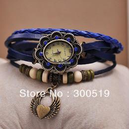 Descuento cuero reloj pulsera corazón Las alas de la correa de cuero genuinas de las mujeres JW462 y los relojes pendientes del corazón forman a señora Bracelet Quartz de la vendimia Relojes de pulsera