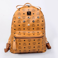 Wholesale 2014 Korean MCM fashion backpacks full rivets elements fashion backpack shoulders