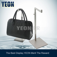 Wholesale YEON stainless steel adjustable height bag display rack women clutch bag display riser for fashion stores