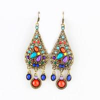 Dangle & Chandelier animated style - Hot Selling Ethnic Style Beads Alloy Dangle Earrings Long Animated Earrings Bijoux