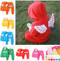 Wholesale 2014 New Children s Outfits amp Sets girl s suits Lovely Angel wings long sleeve hooded coat pants piece sets color choices sets