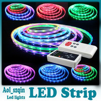 Wholesale 5m smd led strip dream color rgb waterproof leds m program with RF controller V A power supply dhl