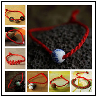 Wholesale free shinppingNatal ward off evil spirits and praying hand woven red string line blue and white ceramic beads jewelry lucky hand rope bracel
