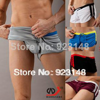 Wholesale Net male sports athletics shorts male fitness running breathable shorts fashion men shorts quick drying