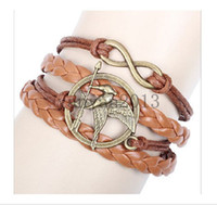 Wholesale European and American retro word notes infinite wings Hunger Games parrot birds Multilayer Hot Selling Charm Leather Bracelets