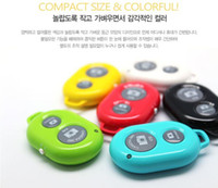 Wholesale Wireless Bluetooth Remote Shutter photo Camera Control Self timer Shutter for iPhone Galaxy S4 S3 Note3 Android4 Smart phone set