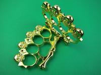 Wholesale GOLDED Four SKULL knuckle duster KNUCKLES Belt Buckle Best gift for friends