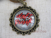Wholesale Daft punk band zinc alloy glass pendant retro necklace for girls boys