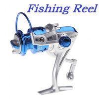 Cheap High quality 8BB Ball Bearings Left Right Interchangeable Collapsible Handle Fishing Spinning Reel ST2000 5.1:1 40pcs lot Via EMS