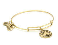 Europe and America alloy brass wire - quot Charity By Design quot Paw Print Expandable Wire Bangle Bracelet new product charm bangles