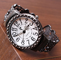 Wholesale Hollow out ladies watch restoring ancient ways Metal strap round watch Pointer and digital bracelet watches Cheap jewelry Y