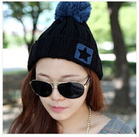 Wholesale The New South Korean star super ball of fur knitted Cap Hat Lady of autumn and winter moisture cap