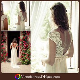 Wholesale White Chiffon A Line Beach Wedding Dresses With Open Back Cap Sleeve V Neck Empire Waists Floor Length Summer Backless Bridal Gown