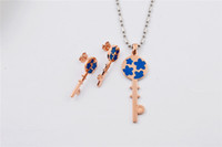 Wholesale Women fashion yellow rose gold L stainless steel vintage blue enamel flower key pendant necklace stud earrings jewelry set SJS0212