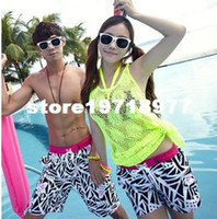 Men Bikinis Dot swimwear Free shipping 2014 Korean version of the Korean version of beach lovers beach pants casual loose shorts quick-drying fabric