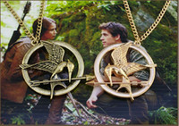 4.5x4.5cm cinnamon - HOT SALE The UK amp US fashion Hunger games LOGO Laugh at the bird long Necklace amp The Cinnamon Gold pendant