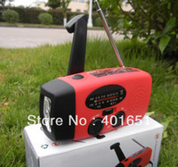 Wholesale 2pcs Emergency Dynamo Solar Self Powered AM FM Radio LED Light amp Chargers for iphone