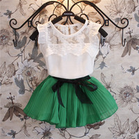 Girl Summer Sleeveless 2014 Summer Children Clothing Girls 2pcs Sets Kid Short Sleeve Lace T Shirt Tops + Bow Pleated Skirt Outfit Kids Girl Sweet Outfits