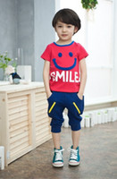 Unisex Summer Short Wholesale 2014 summer new children 's clothes suit with a smile on T-shirt in cotton