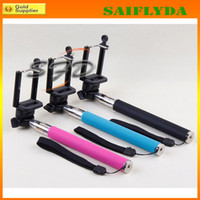 Wholesale Camera Tripod Extendable Handheld Camera selfie monopod With Cellphone Holder For iPhone Samsung HTC Digital Camera