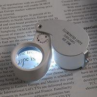 LED joyeros lupa de 40 x 25 mm de cristal de la joyería de la lupa LED de luz de los ojos del sello
