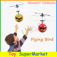 other other other Wholesale-Flying Toys Bird Saucer UFO RC Remote Hand Infrared Induction Control Helicopter Quadcopter Flying Ball 2014 New Electronic Toys